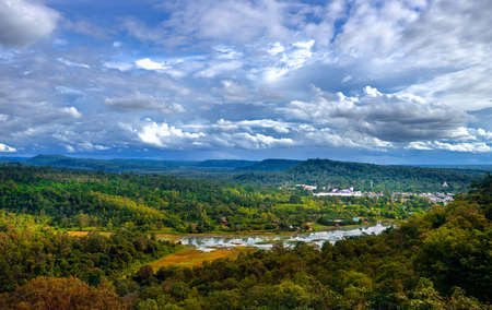 Peaceful forest and mountains over Chong Mek checkpoint terminal, the land bridge permanent border pass to Laos. View from Wat Phu Prao, Ubon Ratchathani, Thailand.