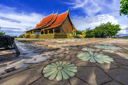 Marvel at the color and beauty of Sirindhorn Wararam Phu Prao Temple during the day, Ubon Ratchathani Province, Thailand