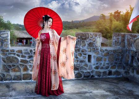 Asian woman wearing a red Chinese culture dress visit Santichon Village, Pai, Mae Hong Son province, Thailand Stok Fotoğraf