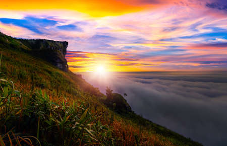 Sunrise and Mist mountain in Phu Chi Fa located in Chiang Rai, Thailand. Phu Chi Fa is the natural border between Thailand and Laos