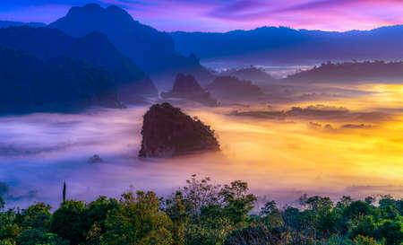 Sunrise and morning mist at Pha Chang Noi Viewpoint, Phu Langka National Park, Phayao Province, Thailand