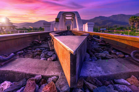 Sunrise at railway bridge cross over the river in Lamphun province in the north of Thailand