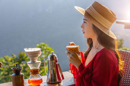 Tourists are dripping coffee at Ban Phahee, Chiang Rai Province, Thailand