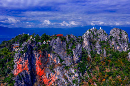 Pagoda on top of the cliff high mountain at Chae-Hom District, Lampang province,Thailand