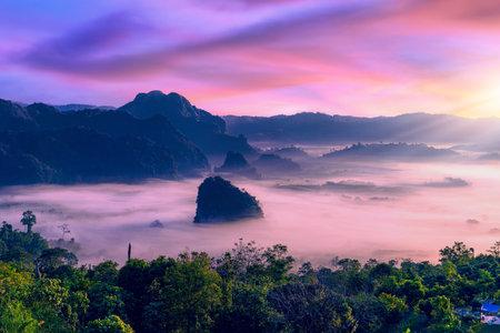 Sunrise and morning fog at Pha Chang Noi Viewpoint, Phu Langka National Park, Phayao Province, Thailand