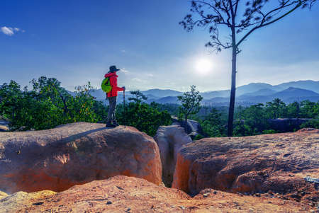 Male tourists stand on the viewpoint of Pai Canyon in Pai District, Mae Hong Son Province, Thailand Imagens