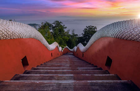 Sunrise with fog at stairway up to Wat Phra That Doi Phra Chan is another beautiful temple in Mae Ta District, Lampang Province, Thailand.