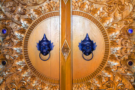 Beautiful Pattern of Ancient Thai wood carvings by the belief of the Thai people on Temple gate.Doi phra shan temple,Lampang province,Thailand
