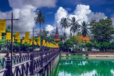 The wooden bridge cross to Wat Trapang Thong, Sukhothai. Located within Sukhothai Historical Park, Thailand