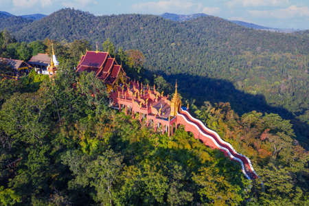 Aerial view of Wat Phra That Doi Phra Chan on the top hill of Doi Phra Chan mountain in Mae Tha, Lampang province, Thailand Editorial