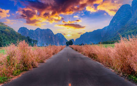 Road to the Mountains with sunset in Uthai thani .Thailand