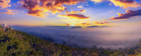 Panorama with fog in the winter morning covers the village below in Li District, Lamphun Province, Thailand
