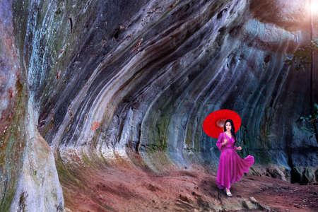 Asian woman visit Pha Khong Cave, a tourist attraction in Phetchabun Province, Thailand