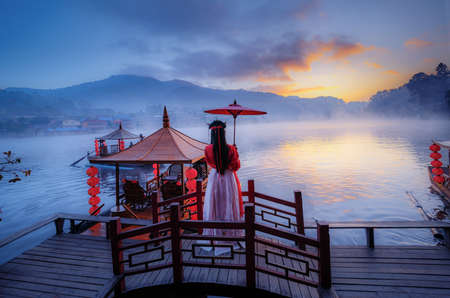 The sunrise and mist cover the reservoir at Ban Rak Thai, which is popular with tourists in Mae Hong Son Province, Thailand