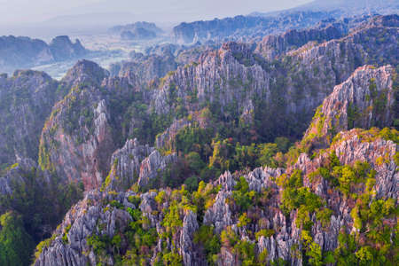Aerial view of sharp limestone mountains in Noen Maprang District, Phitsanulok Province, Thailand.