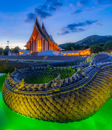 Thammayan Temple is a meditation place for Buddhist people and has a church with a serpent statue in front, Phetchabun, Thailand