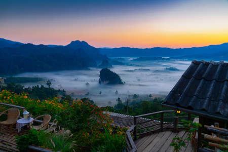 Sunrise and morning mist at Pha Chang Noi Viewpoint, Phu Langka National Park, Phayao Province, Thailand.