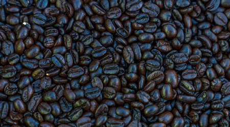 Details of roasted black coffee beans background