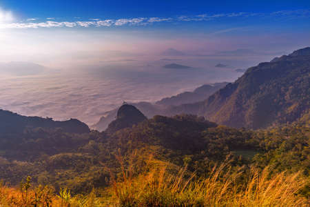 Sunrise and misty at Doi Pha mon viewpoint, Chiangrai province, Thailand.