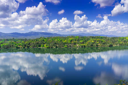 Lake with blue sky at the old lignite coal mine in Phayao Province, Thailand. Imagens