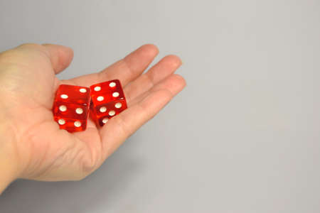 dado: Red dices in the hand Stock Photo