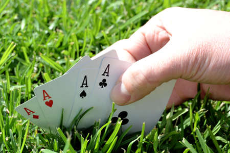 bluff: poker card in the grass