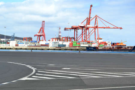 sours: Cranes and container on the dock Editorial