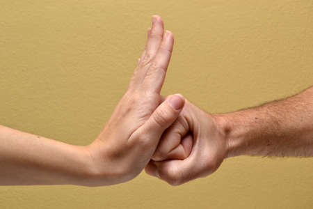 banging: Hitting punch in hand Stock Photo