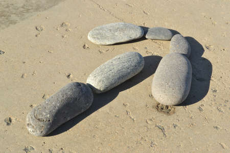 Row by stones in the form of an arrow photo