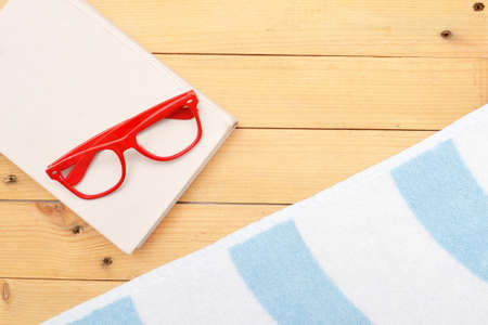Book, glasses and beach towel photo