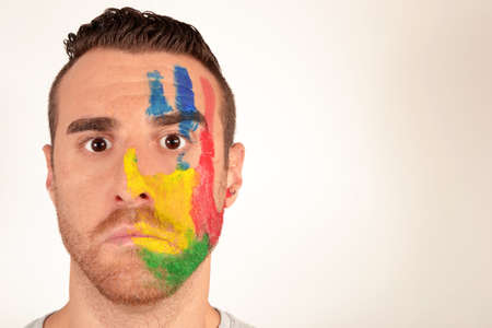 painted face: Man with painted face