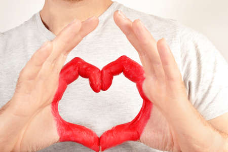 shaped hands: Man with heart shaped hands