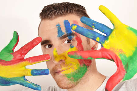 negoro: Man looking into the camera with painted hands