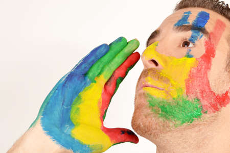 Young man screaming with hand painted face Stock Photo