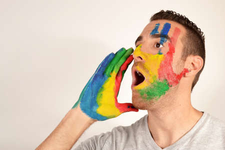 negoro: Young man screaming with hand painted face Stock Photo