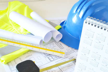hard cap: Helmet and tools for construction drawings Stock Photo