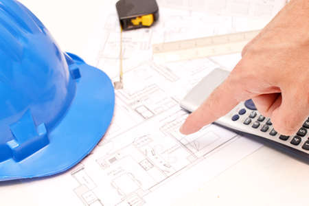 Helmet and tools for construction drawings photo