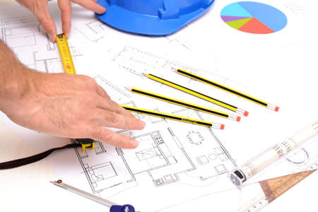 trammel: Helmet and tools for construction drawings Stock Photo