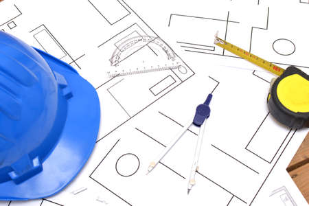 Helmet and tools for construction drawings Stock Photo