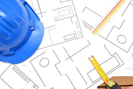 incommunicado: Helmet and tools for construction drawings Stock Photo