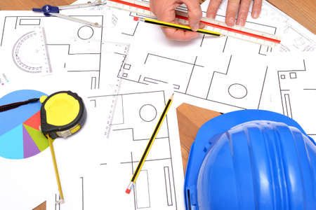 confound: Architect working with blueprints