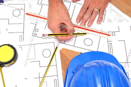 incommunicado: Architect working with blueprints