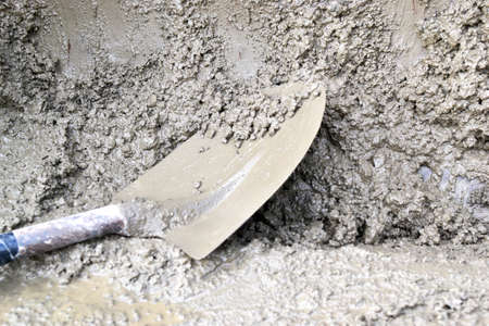 Working with cement at a construction site photo