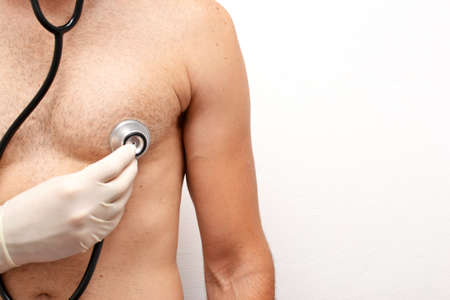 doctor auscultating a patient photo