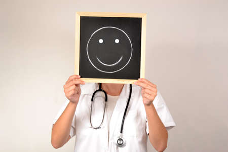 Doctor with smiling face in blackboard photo