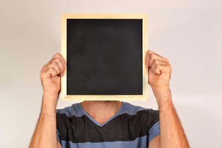 Man with blackboard photo