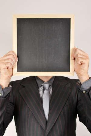 Businessman with blackboard photo