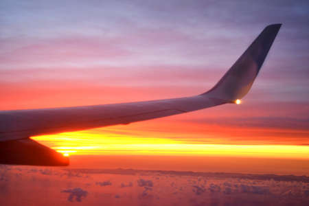Airplane flying at dawn photo