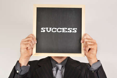 Businessman with message success photo