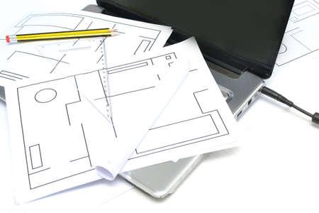 Architect plans and laptop photo